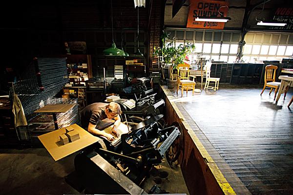John Reburn of Appalachia Press pores over his letterpress designs