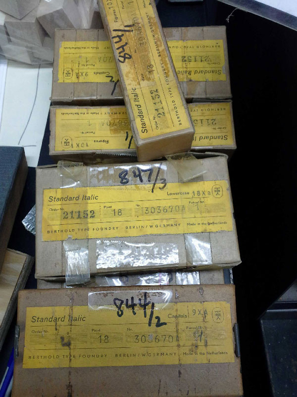 Packages of type at Bow & Arrow Studio on the Harvard Campus
