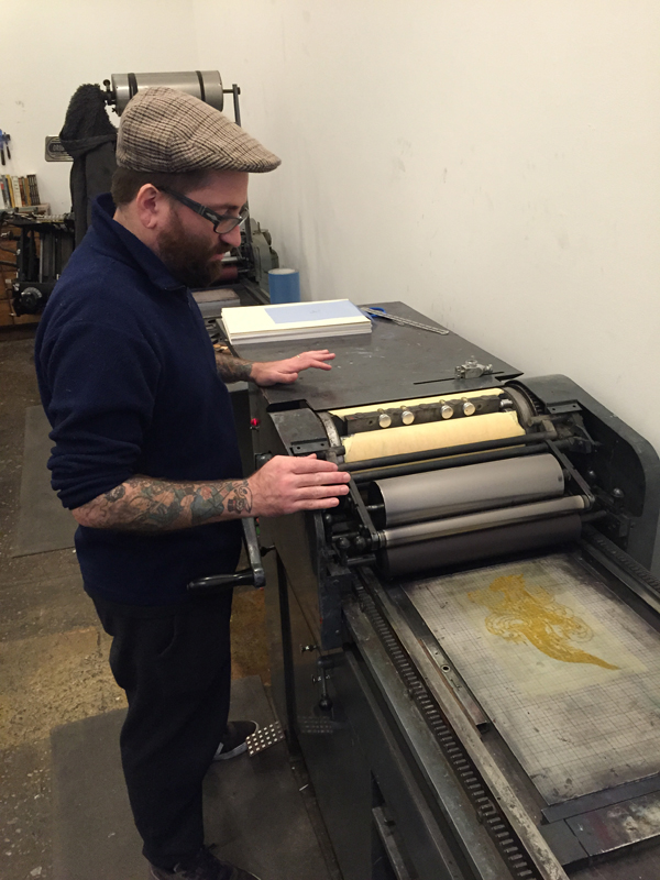 John Reardon printing on a Vandercook.