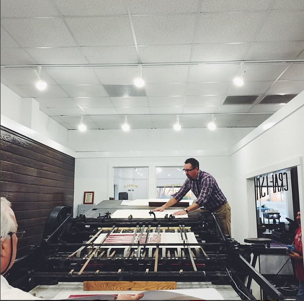Printing on the Miehle press at Cotton and Pine.