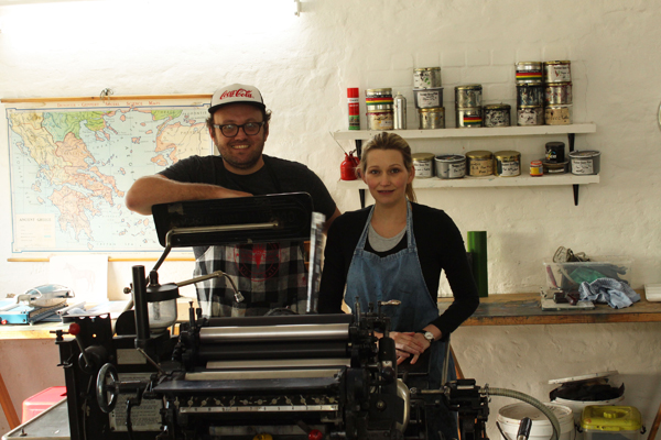 Ben and Vanessa Grib of Essie Letterpress stand proudly with their Heidelberg Windmill.