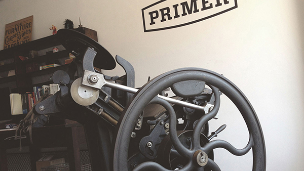 A beautiful Chandler & Price letterpress press stands ready for printing fun at Primer.