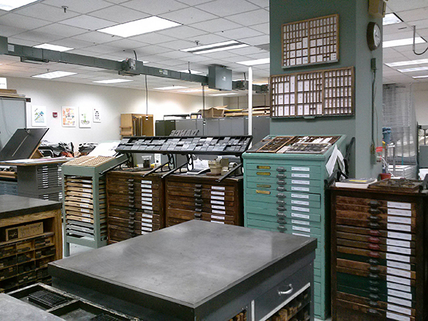 A huge galley of type stands alluring at the Madison College Center For Printing Arts.