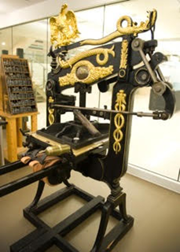 A beautiful iron hand press awaits to be used at the Book Arts Program and Red Butte Press at the University of Utah.