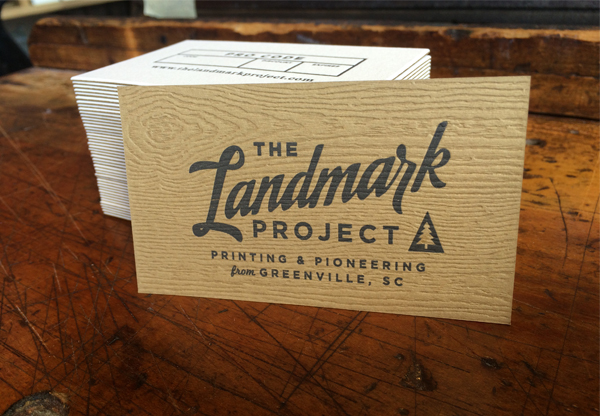 Dapper Ink letterpress business card that beautifully uses wood grain pattern effectively and brilliantly.