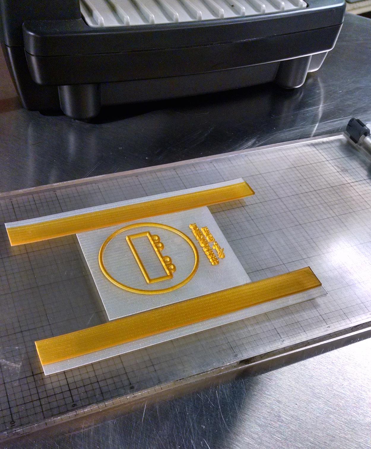 L Letterpress DIY letterpress printing photopolymer printing plate with inking roller bearer strips.