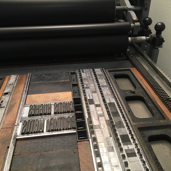 Laura Bentley prints on a Vandercook for SVC Children's Broadsides.