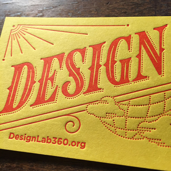 Red on yellow stock paper letterpress printed business card by the Cranky Pressman.