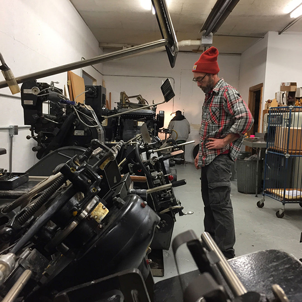 Keith Berger of the Cranky Pressman inspects his Heidelberg Windmill.