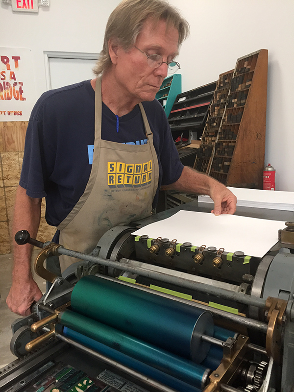 Tom Virgin of Extra Virgin Press prints on a Vandercook.