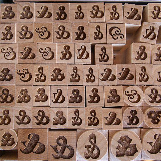Ampersands, letterpress printing, wood carvings.
